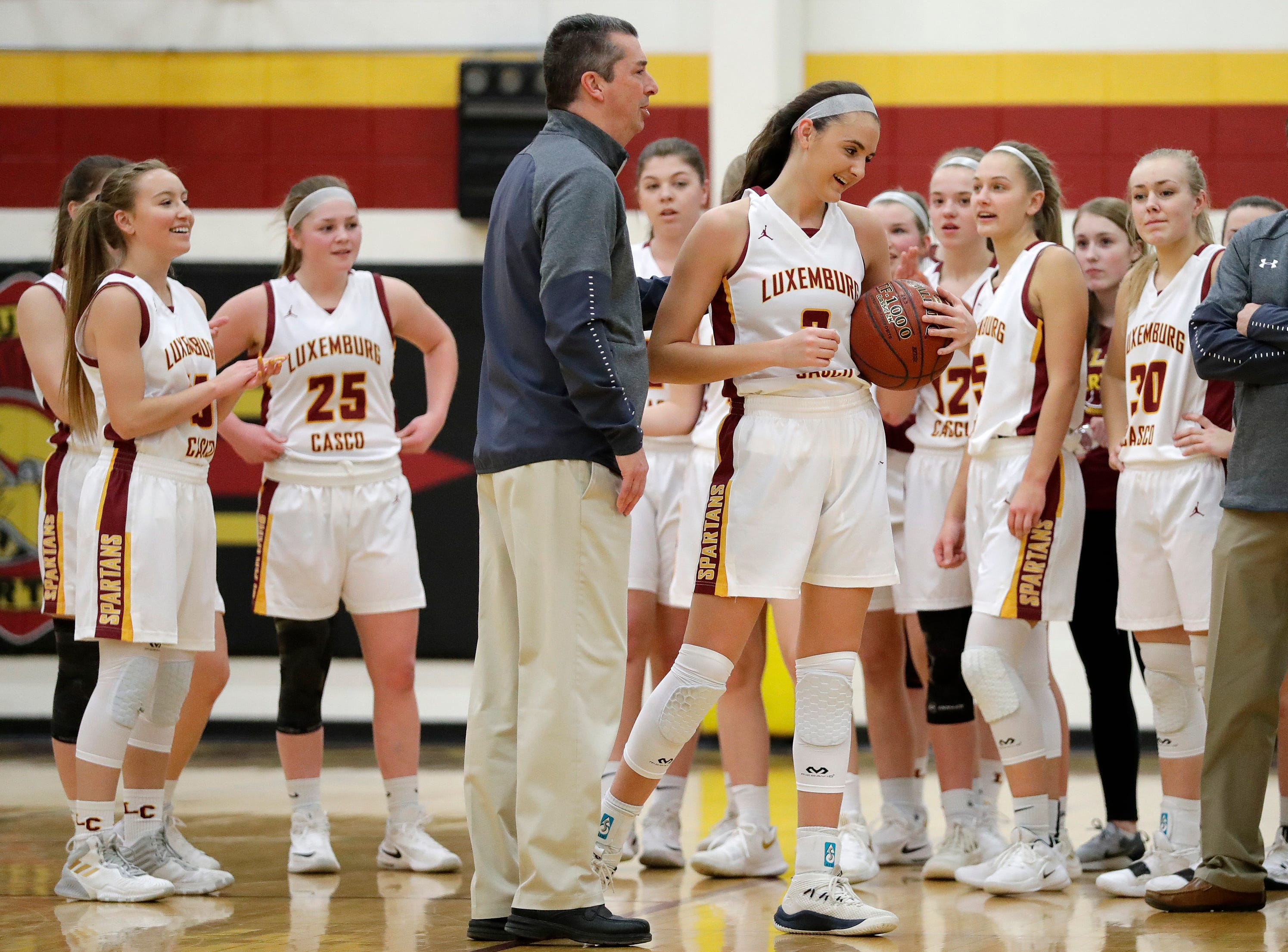 Luxemburg-Casco's Cassie Schiltz (3) is honored after breaking the school's all-time scoring record with her 1679th point in a girls basketball game against Waupaca at Luxemburg-Casco high school on Thursday, January 10, 2019 in Luxemburg, Wis. The record was previously set at 1678 by Rachel Porath in 2004.