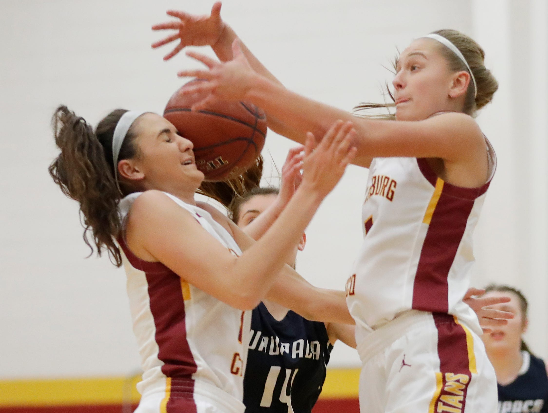 Luxemburg-Casco's Cassie Schiltz (3) and Jenna Jorgensen (5) collide while diving for a loose ball against Waupaca in a girls basketball game at Luxemburg-Casco high school on Thursday, January 10, 2019 in Luxemburg, Wis.