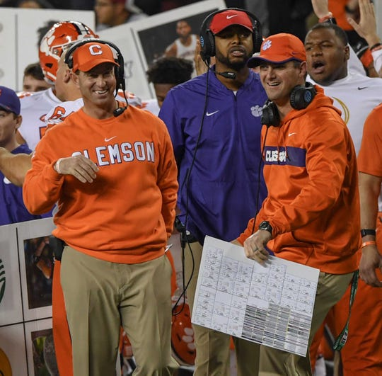 Clemson Head Coach Dabo Swinney smiles with Clemson wide receiver coach Jeff Scott in a game which the Tigers beat Alabama 44-16 in the College Football Championship game at Levi's Stadium in Santa Clara, California Monday, January 7, 2019.