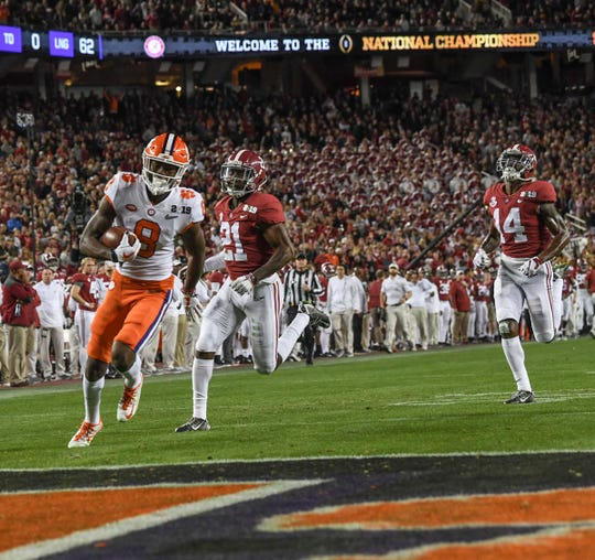 Clemson wide receiver Justyn Ross (8) runs by Alabama defensive back Jared Mayden (21) for a touchdown during the first quarter of the College Football Championship at Levi's Stadium in Santa Clara, California Monday, January 7, 2019.