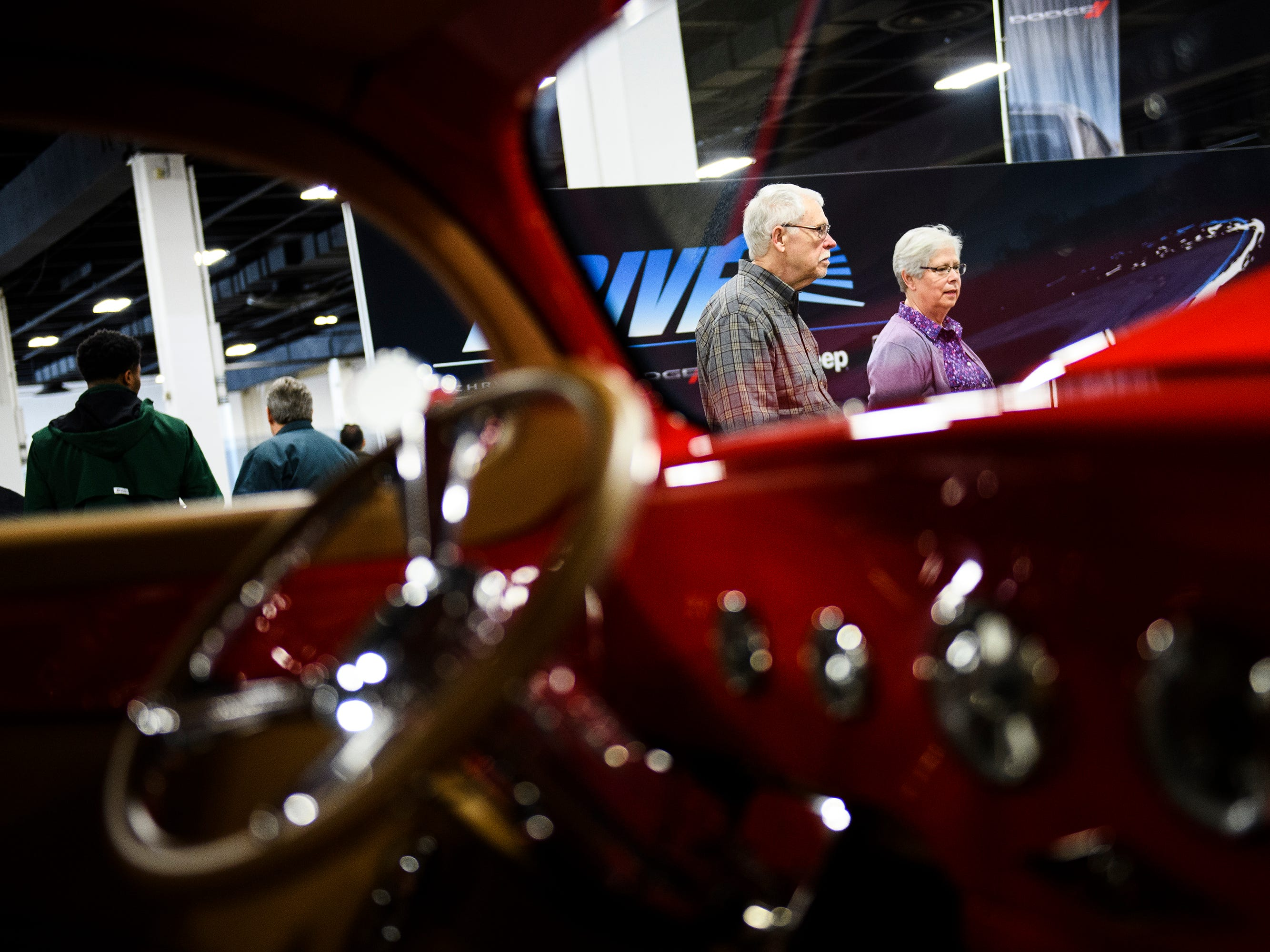 John and John Beezley look at classic cars during the South Carolina International Auto Show Friday, Jan. 11, 2019 at the Greenville Convention Center.