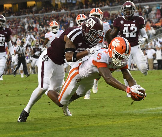 Clemson wide receiver Tee Higgins (5) scores past Texas A&M defensive back Charles Oliver (21) during the 2nd quarter at Texas A&M's Kyle Field in College Station, TX Saturday, September 8, 2018.