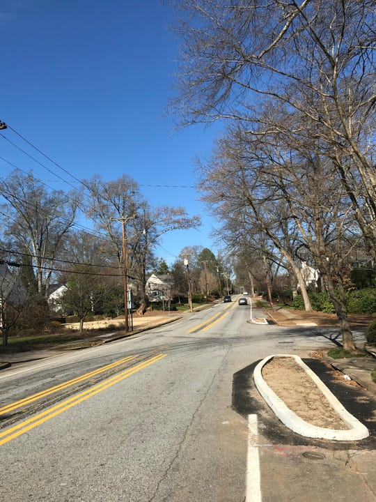 New curbed islands added to McDaniel Avenue are intended to slow drivers in the area.