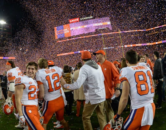 Clemson wide receiver Will Swinney (22), left, and brother wide receiver Drew Swinney (81) celebrate with teammates after the Tigers beat Alabama 44-16 at the College Football Championship game at Levi's Stadium in Santa Clara, California Monday, January 7, 2019.