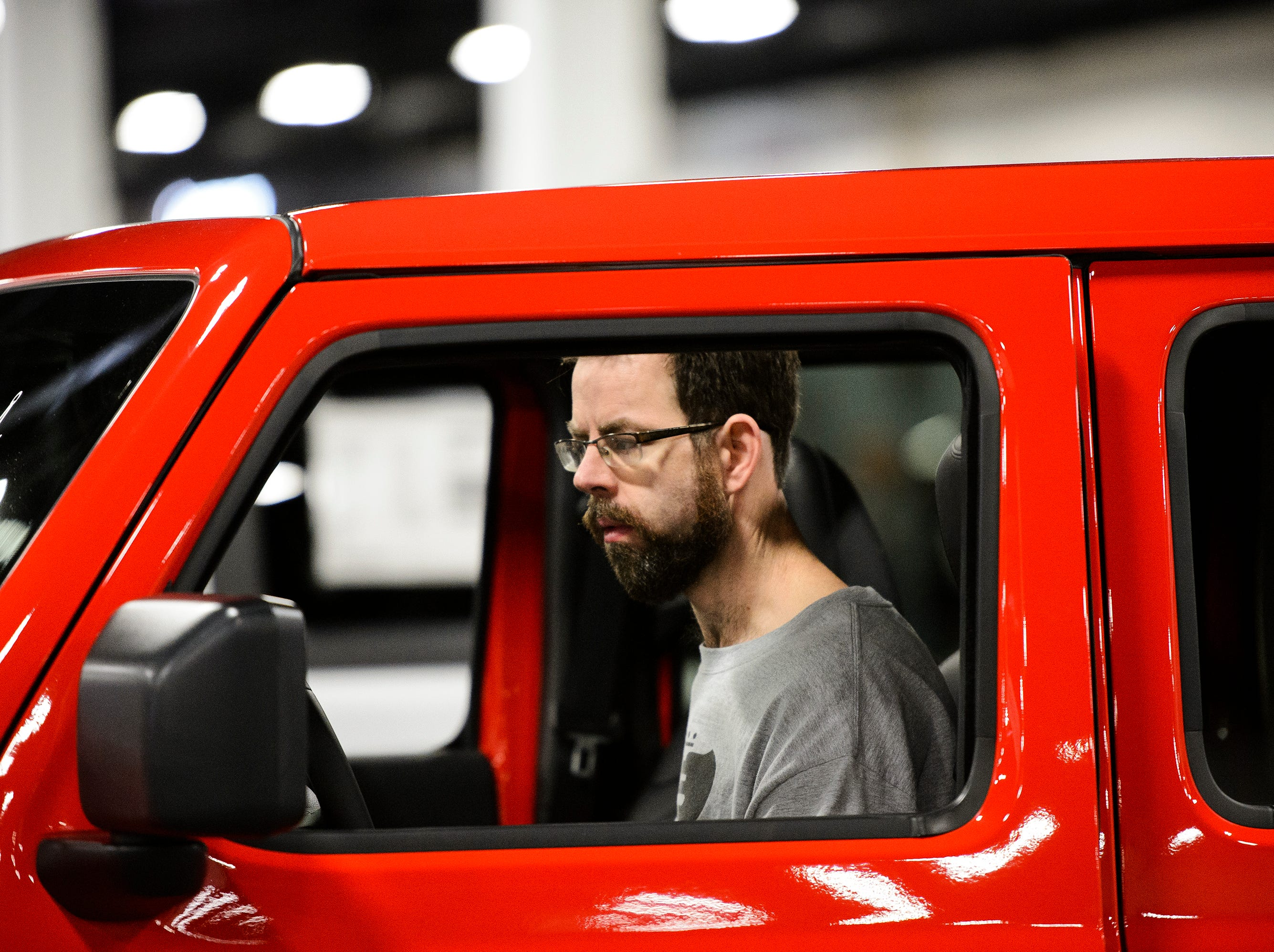 Timothy Brown checks out the interior of a vehicle during the South Carolina International Auto Show Friday, Jan. 11, 2019 at the Greenville Convention Center.