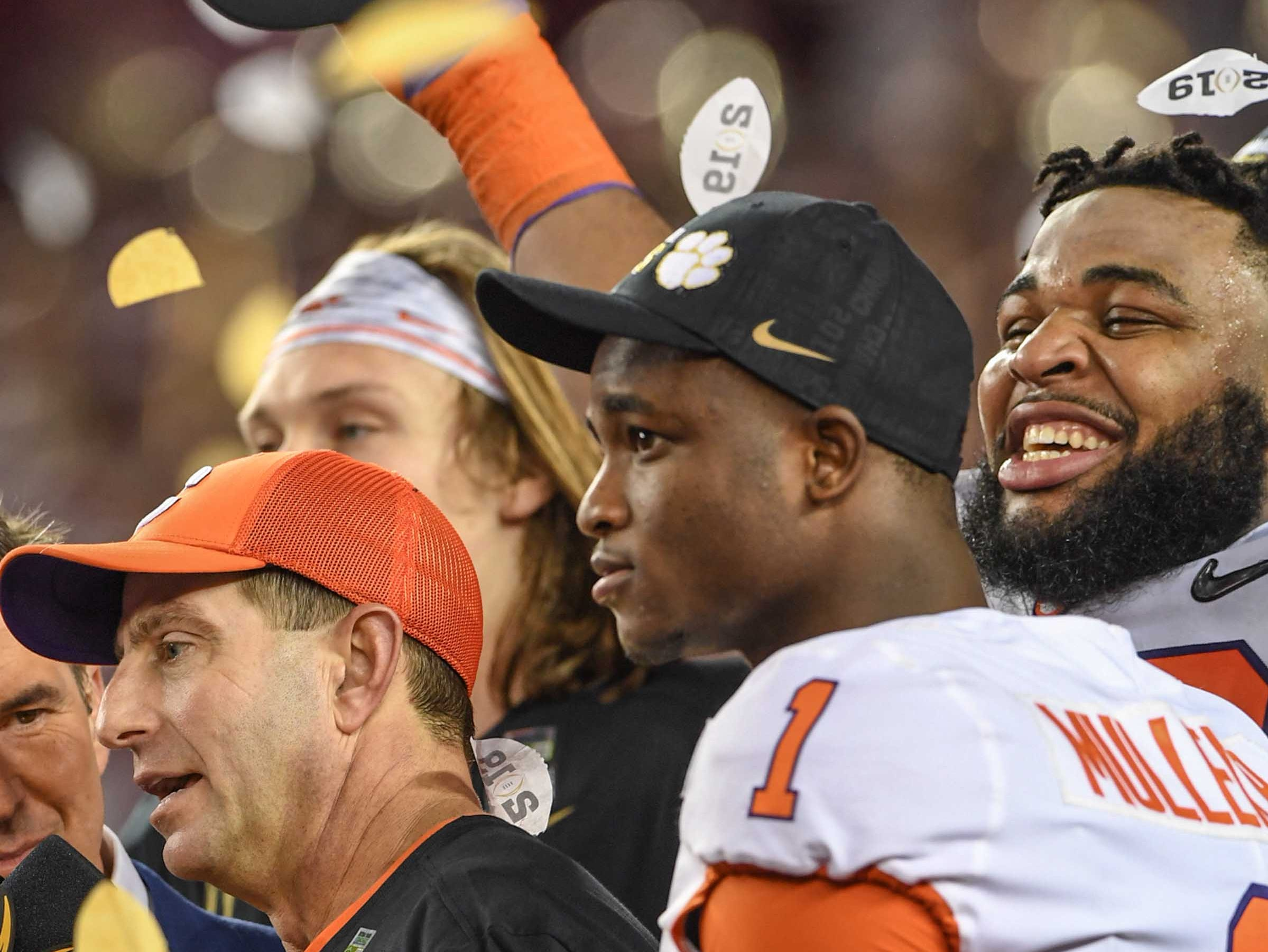 Clemson Head Coach Dabo Swinney holds the trophy near cornerback Trayvon Mullen (1) and defensive lineman Christian Wilkins (42) after the Tigers beat Alabama 44-16 at the College Football Championship game at Levi's Stadium in Santa Clara, California Monday, January 7, 2019.