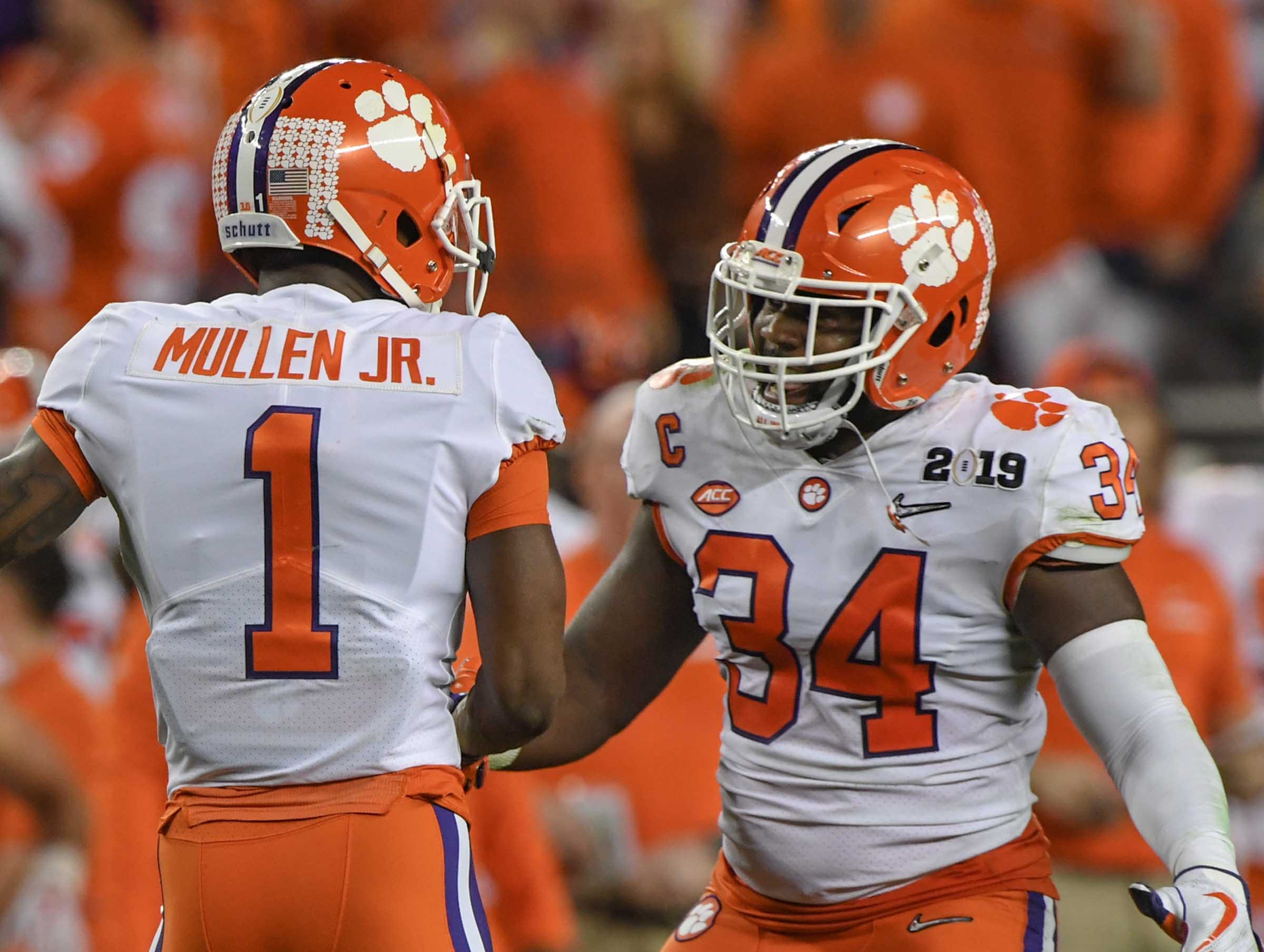Clemson cornerback Trayvon Mullen (1) and linebacker Kendall Joseph (34) celebrate a stop against Alabama during the the second quarter of the College Football Championship at Levi's Stadium in Santa Clara, California Monday, January 7, 2019.