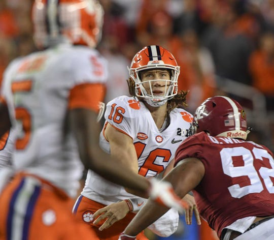 Clemson quarterback Trevor Lawrence (16) throws to wide receiver Tee Higgins (5) near Alabama defensive lineman Quinnen Williams (92) during the the second quarter of the College Football Championship at Levi's Stadium in Santa Clara, California Monday, January 7, 2019.
