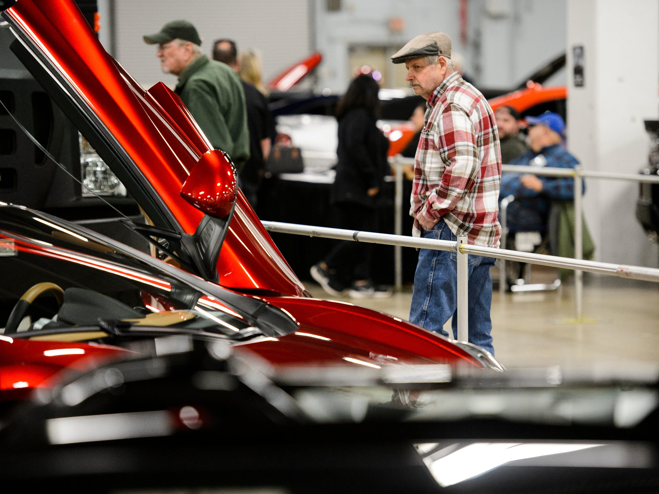 Al Schaefer looks at exotic cars during the South Carolina International Auto Show Friday, Jan. 11, 2019 at the Greenville Convention Center.