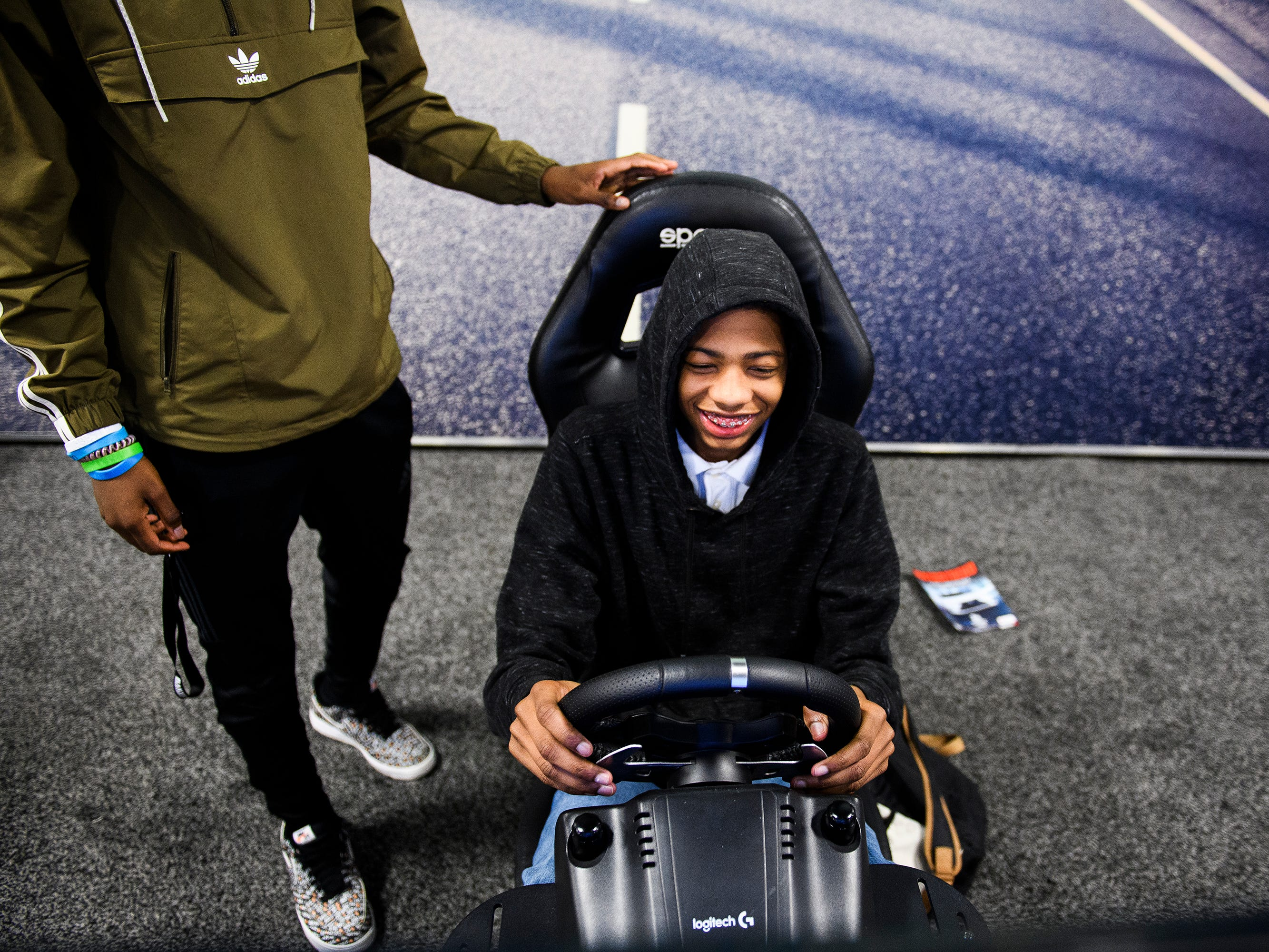 Tydriques Sullivan plays a racing game during the South Carolina International Auto Show Friday, Jan. 11, 2019 at the Greenville Convention Center.