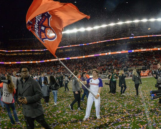 A Clemson cheerleader waves a National Championship flag after a 44-16 win over Alabama in the College Football Championship game at Levi's Stadium in Santa Clara, California Monday, January 7, 2019.