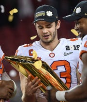 Clemson wide receiver Hunter Renfrow (13) holds the trophy after the Tigers beat Alabama 44-16 at the College Football Championship game at Levi's Stadium in Santa Clara, California Monday, January 7, 2019.