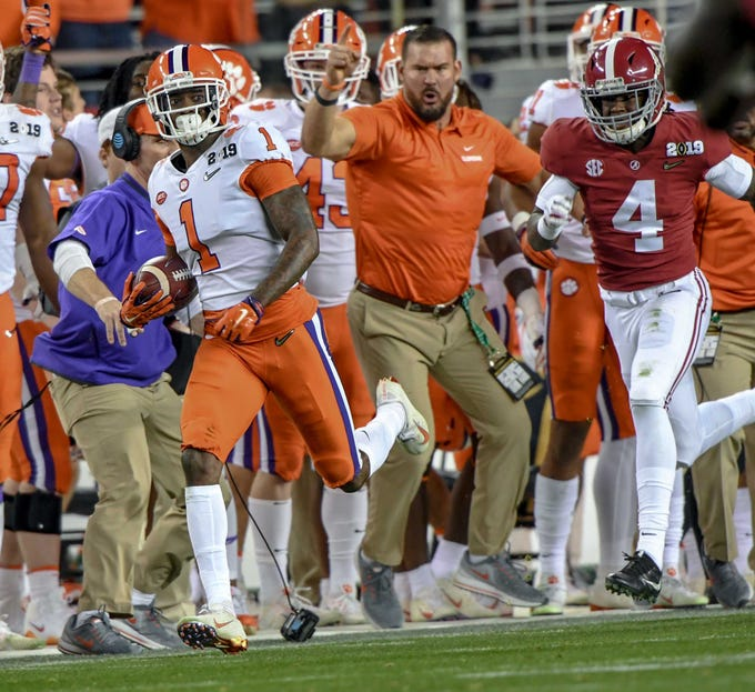 Clemson cornerback Trayvon Mullen (1) runs by Alabama wide receiver Jerry Jeudy (4) after intercepting a pass during the the second quarter of the College Football Championship at Levi's Stadium in Santa Clara, California Monday, January 7, 2019.