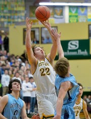 CMR's Keegan Barnes shoots a jump shot during the crosstown boys' basketball game last season.