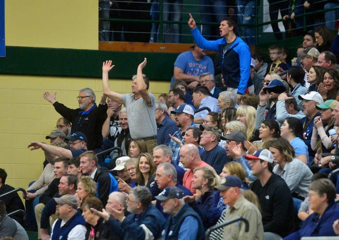 Great Falls High fans voice their displeasure with the referees during Thursday's crosstown basketball game in the CMR Fieldhouse.
