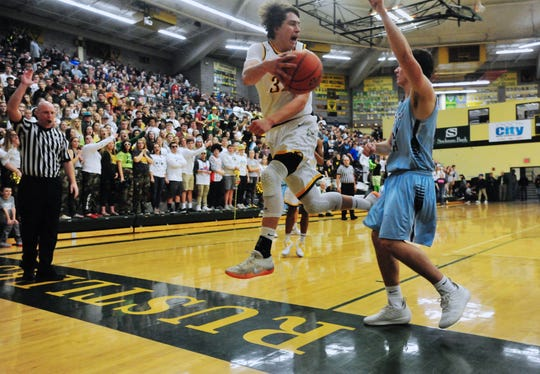 CMR's Bryce Depping attempts to save the ball from going out of bounds during the crosstown basketball game, Thursday night, in the CMR Fieldhouse.
