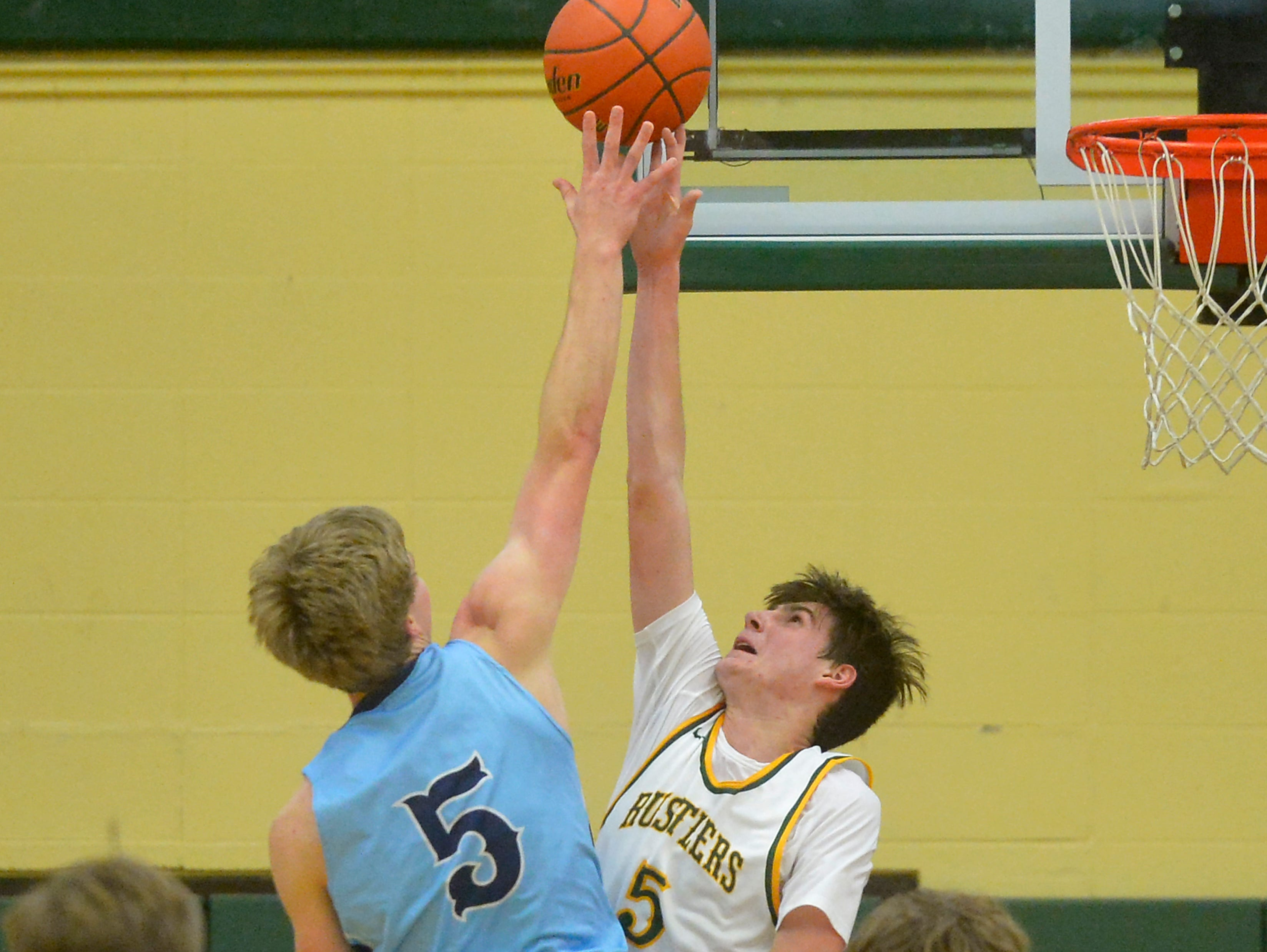 CMR's Brendan Lindseth attempts to block the shot of Great Falls High's Riley Callery during the boys' crosstown basketball game, Thursday night in the CMR Fieldhouse.