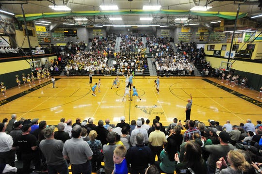 Tipoff of the boys' crosstown basketball game, Thursday night, in the CMR Fieldhouse.