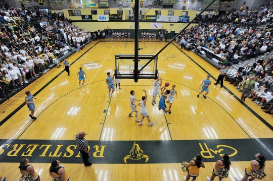 It was a full house at CMR last week as the C.M. Russell High Rustlers took on the Great Falls High Bison in a crosstown boys' basketball game.