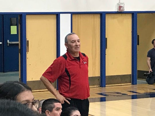 Browning girls' basketball coach Ray Augare looks on as his Lady Indians battle the Havre Blue Ponies Thursday night in Havre.