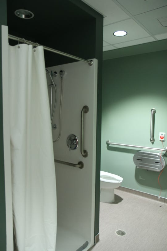Private bathroom located in the back of the Sexual Assault Response Room that allows patients to shower and change after they have been check and taken care of by staff.