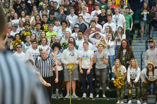 The CMR student section watches the action on the floor late in Thursday's crosstown basketball game in the CMR Fieldhouse.