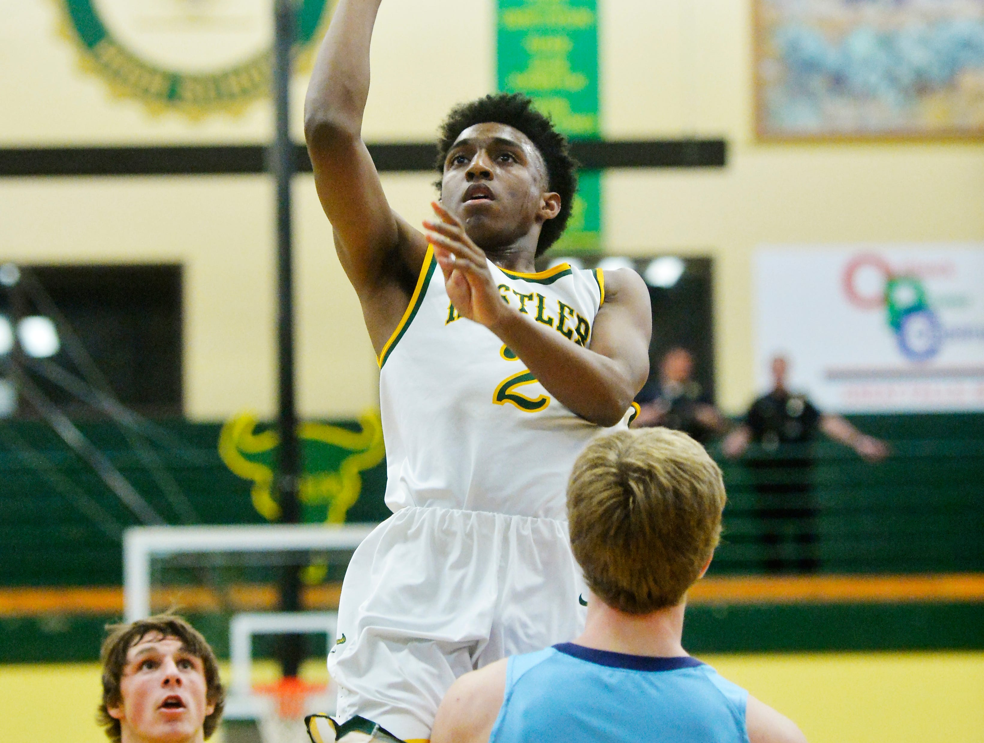 CMR's Caleb Curringtion attempts a shot during the crosstown basketball game, Thursday night, in the CMR Fieldhouse.