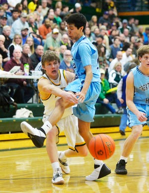 CMR's Cason Taylor makes a pass around Great Falls High defender Cash Abbott during the crosstown basketball game, Thursday night, in the CMR Fieldhouse.