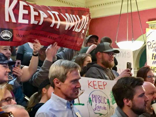 People crowd into the capitol rotunda in Helena on Friday for the public land rally.