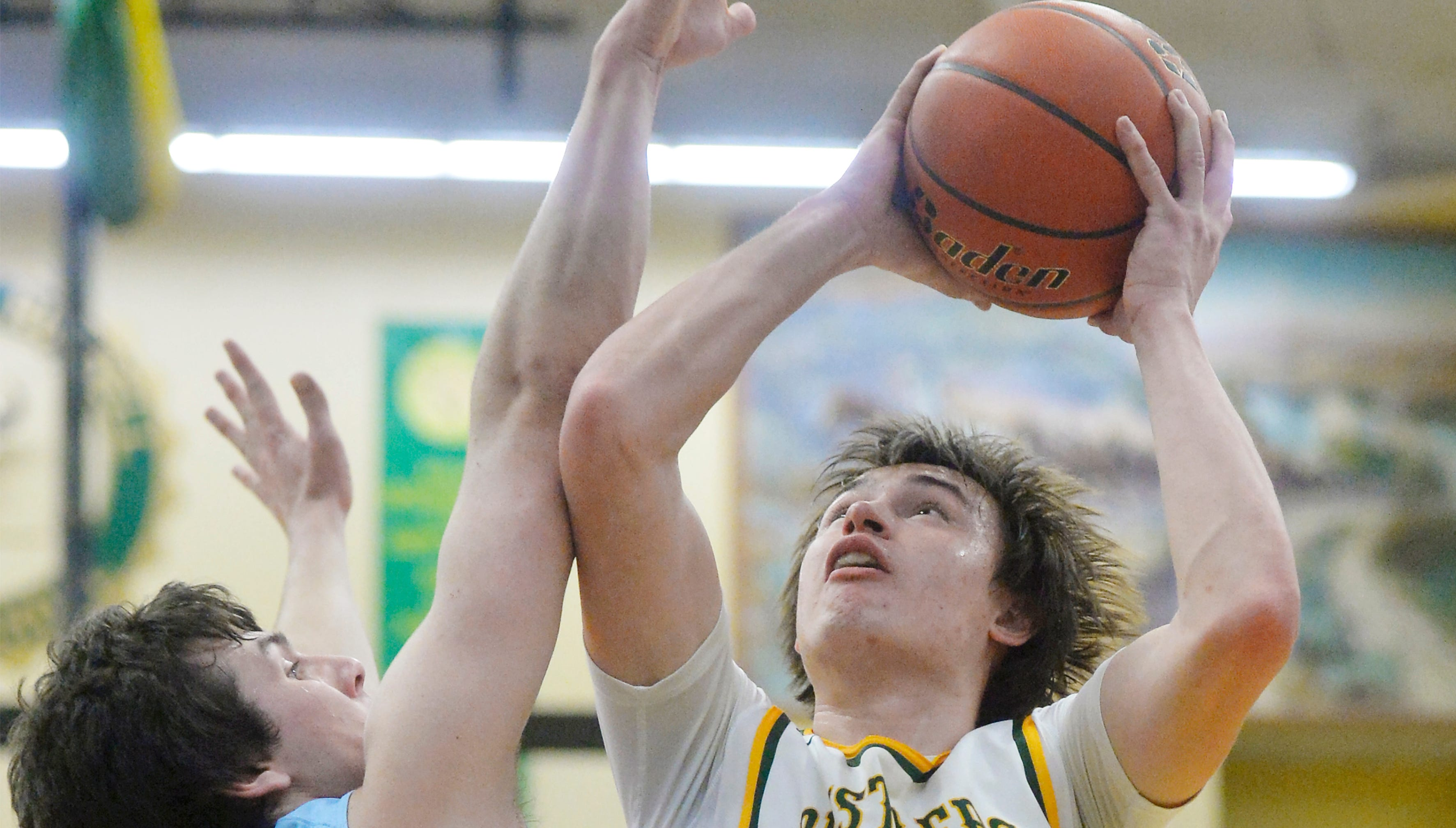A pair of Bison and one player from the Rustlers earned All-State Class AA honors in boys' basketball.