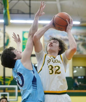 CMR's Bryce Depping attempts to shoot over Great Falls High's Blake Thelen during the crosstown basketball game this past season at the CMR Fieldhouse.