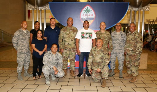 Technical Sgt. Jacob Barnes, from the Guam Air National Guard's 254th Air Base Group's Cyber Flight, at center in white, poses for a photo with members of the Guam Air National Guard at the Guam International Airport Authority over the weekend, just prior to departing for a deployment in support of Operation Inherent Resolve in Southwest Asia.