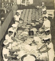"""The original caption for this 1948 photo reads: """"These are some of the 30 bakers who supply the Island with bread, pies and pastries at the bakery operated by Art de Long, an American authority of long standing on baking technique. He is shown standing rear left."""""""