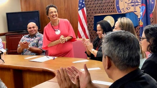 Gov. Lou Leon Guerrero is all smiles as she address officials and employees of A.B. Won Pat International Airport Guam before signing on Jan. 11, 2019 her first proclamation as governor, declaring Jan. 13 to 19 as Airport Week 2019. Looking on are Lt. Gov. Joshua Tenorio, Speaker Tina Muna Barnes and Guam International Airport Authority board chairman Ricardo Duenas.