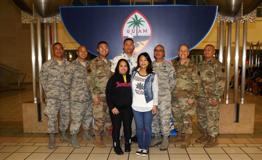 Technical Sgt. Michelle Castro, from the Guam Air National Guard's 254th Air Base Group's Cyber Flight, at center in white, poses for a photo with members of the Guam Air National Guard at the Guam International Airport Authority last week, just prior to departing for a deployment in support of Operation Inherent Resolve in Southwest Asia
