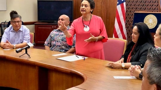 Gov. Lou Leon Guerrero gestures as she address officials and employees of A.B. Won Pat International Airport Guam before signing on Jan. 11, 2019 her first proclamation as governor, declaring Jan. 13 to 19 as Airport Week 2019. Looking on are Lt. Gov. Joshua Tenorio, Speaker Tina Muna Barnes and Guam International Airport Authority board chairman Ricardo Duenas.