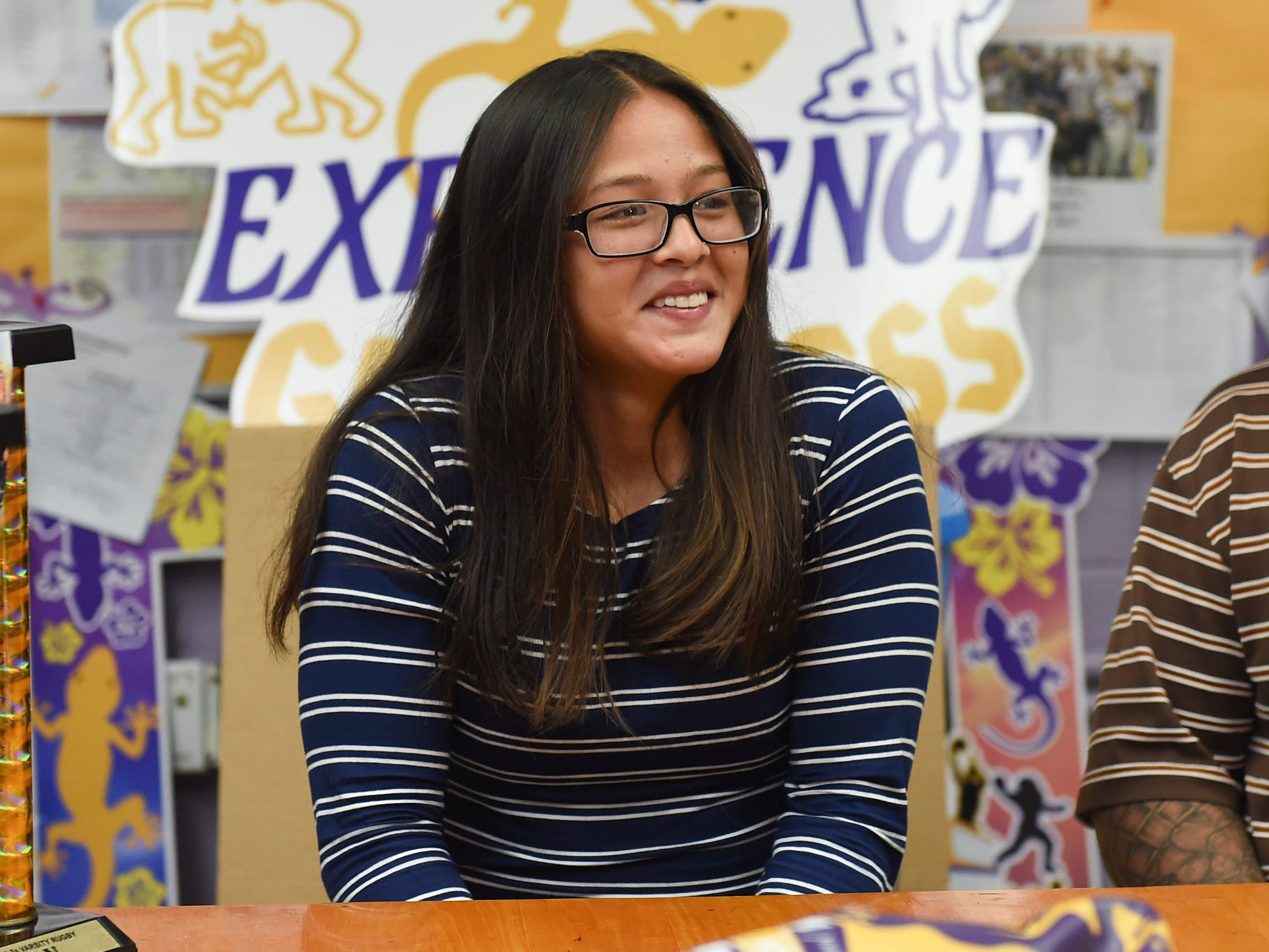 George Washington High School girls' rugby star, Jalana Garcia, 18, displays her excitement before signing a letter of intent with Mount St. Mary's University, at the GWHS main office, Jan. 11, 2019.