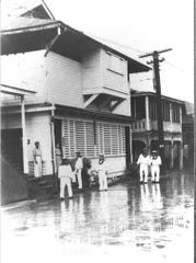 According to the caption on this undated photo, the uniformed men are Japanese soldiers standing outside a restaurant in Hagåtña.