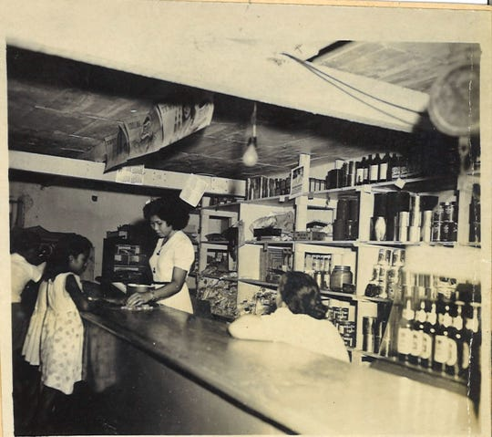 """This undated photo shows the inside of a """"typical country store on Guam."""" According to the caption, this Merizo store was owned by Carmen Cruz."""