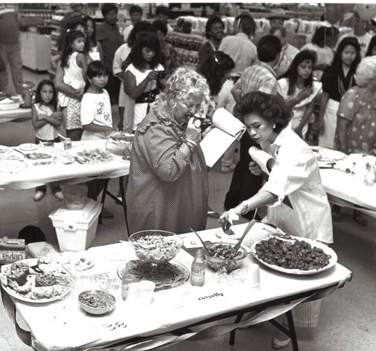 Judges Dorothy Horn and Yoly Zimmer taste food entries during the 1989 Spam Specialty  Competition at Gibson's Shopping Complex. The US military's widespread food relief after WWII is believed to be a factor in the island's love for the canned good.