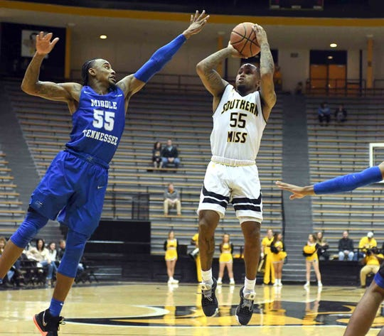 Southern Miss guard Tyree Griffin shoots for the basket in a game against Middle Tennessee in Reed Green Coliseum on Thursday, January 10, 2019.