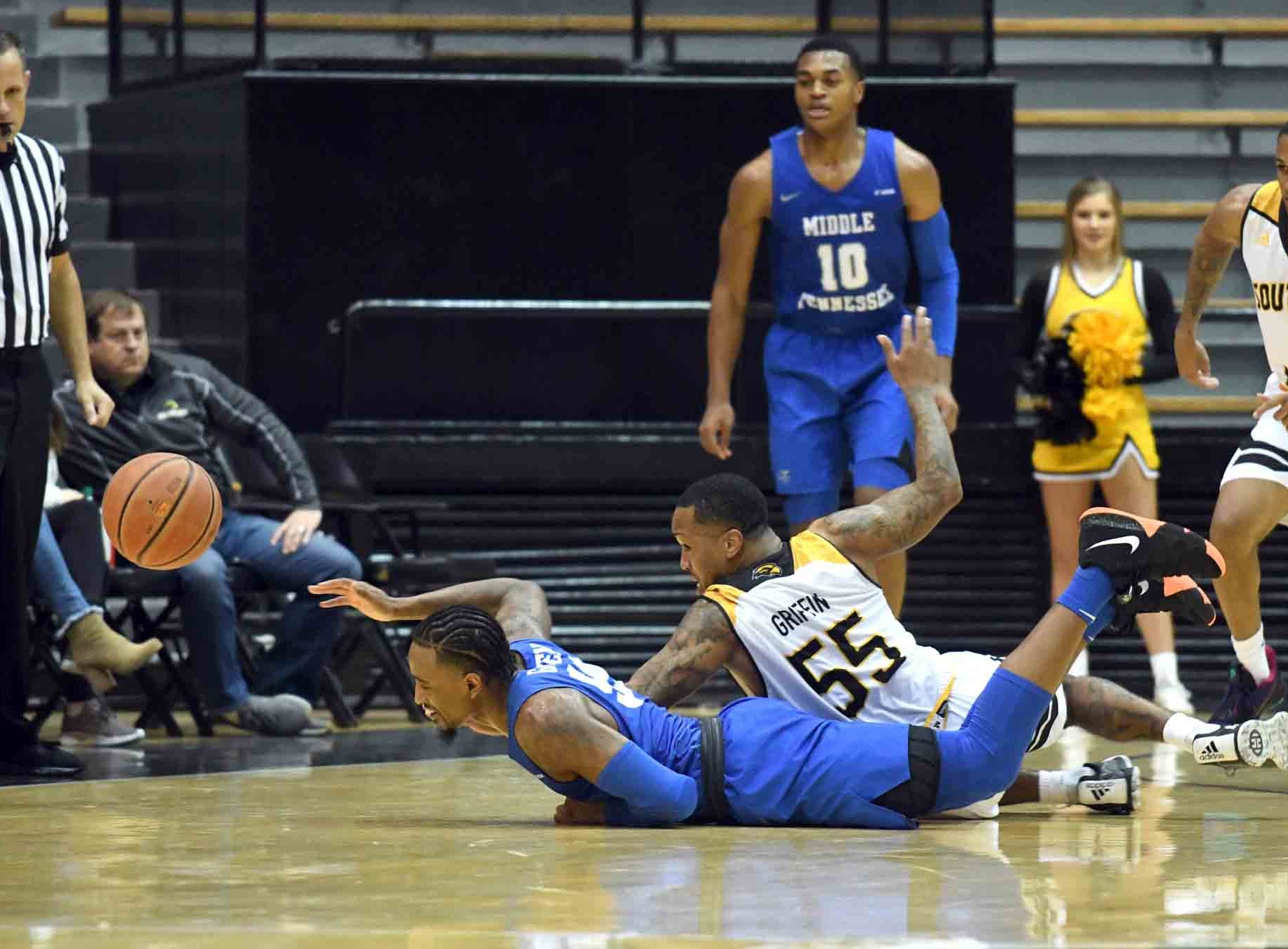Southern Miss guard Tyree Griffin reaches for a loose ball in a game against Middle Tennessee in Reed Green Coliseum on Thursday, January 10, 2019.