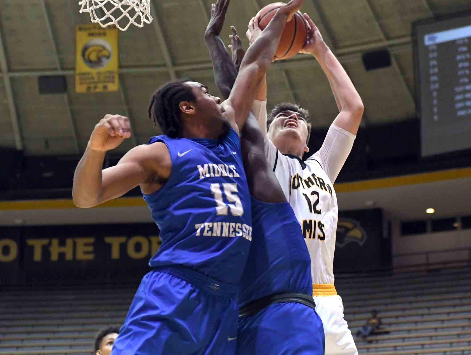 Southern Miss forward Tim Rowe shoots for the basket in a  game against Middle Tennessee in Reed Green Coliseum on Thursday, January 10, 2019.
