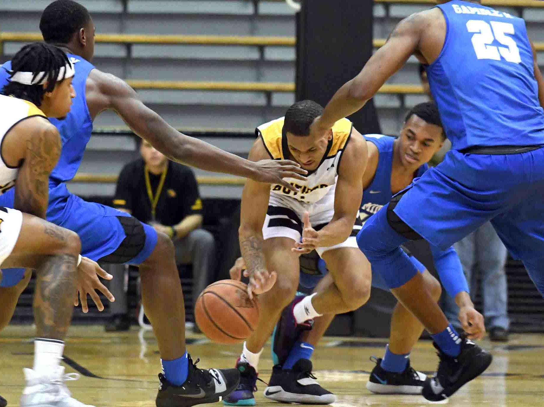 Southern Miss guard Cortez Edwards scrambles for the ball in a game against Middle Tennessee in Reed Green Coliseum on Thursday, January 10, 2019.