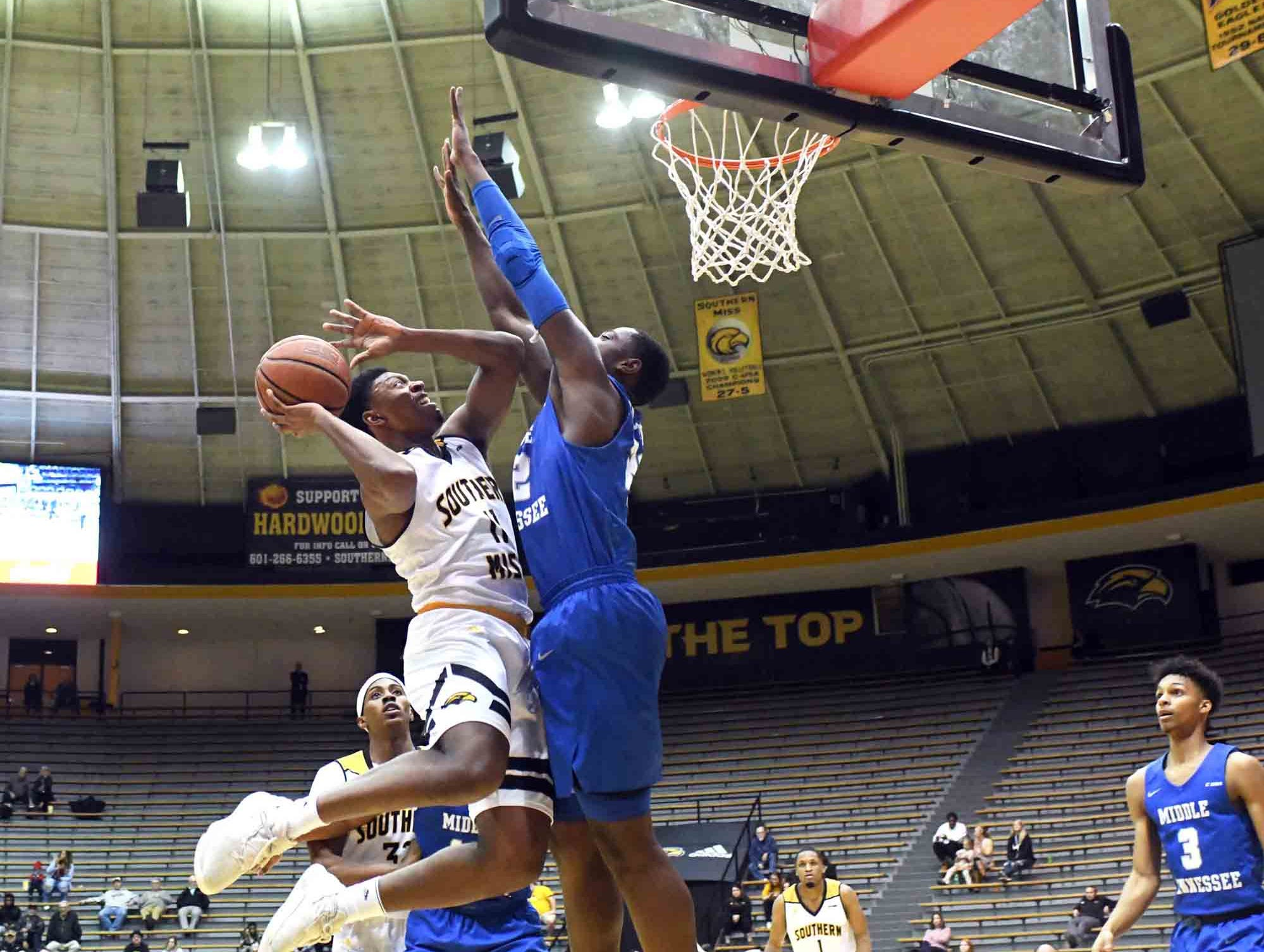 Southern Miss guard Ladavius Draine shoots for the basket in a  game against Middle Tennessee in Reed Green Coliseum on Thursday, January 10, 2019.