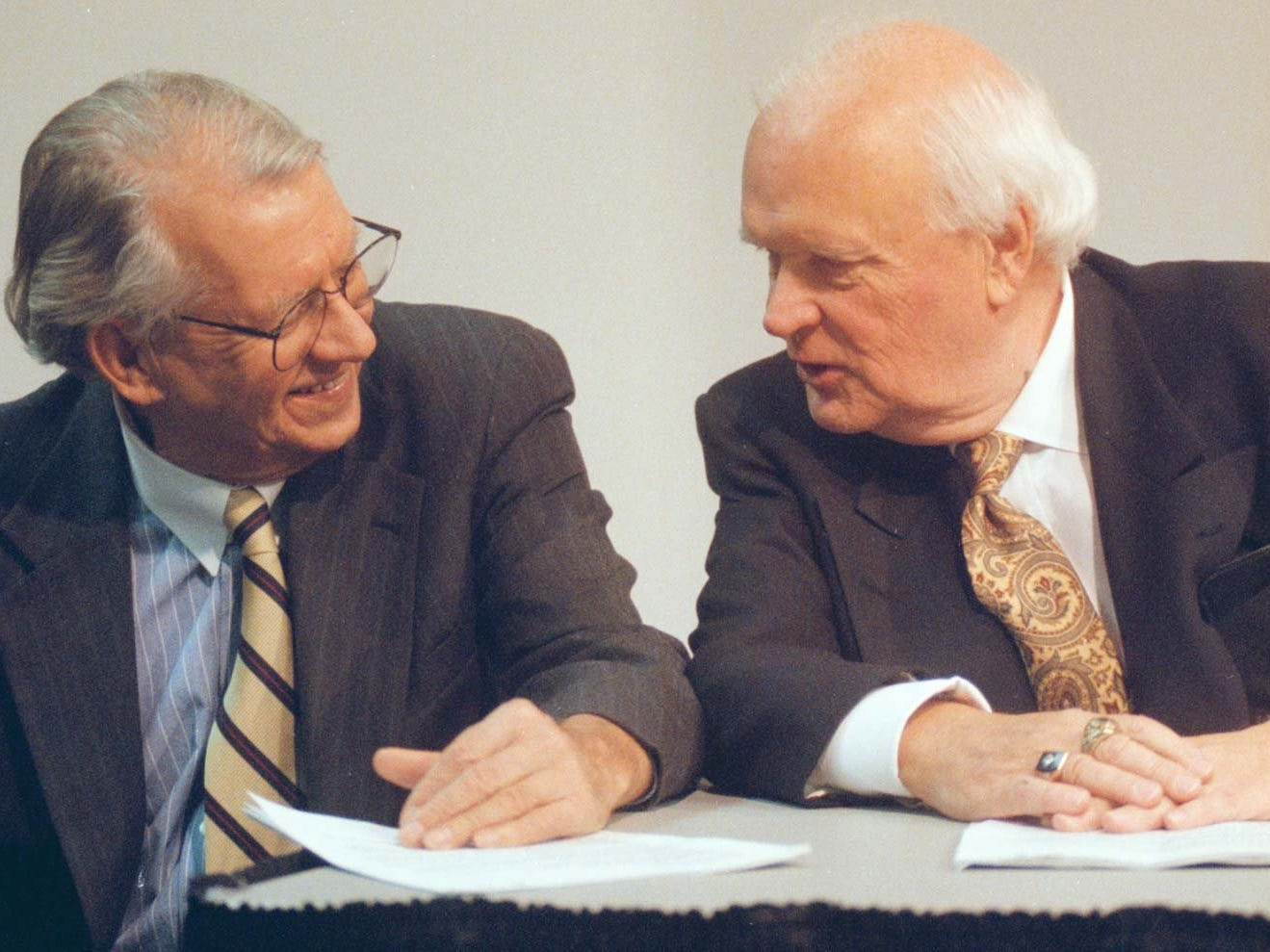"From 1996: Broadcasters Jim Zabel, left, and Bob Brooks chat before a press conference Friday introducing Gary Dolphin as the new play-by-play voice of Iowa football and basketball games. ""I am philosophical about it, but I can't say that I like it,"" Zabel said. ""I don't."""