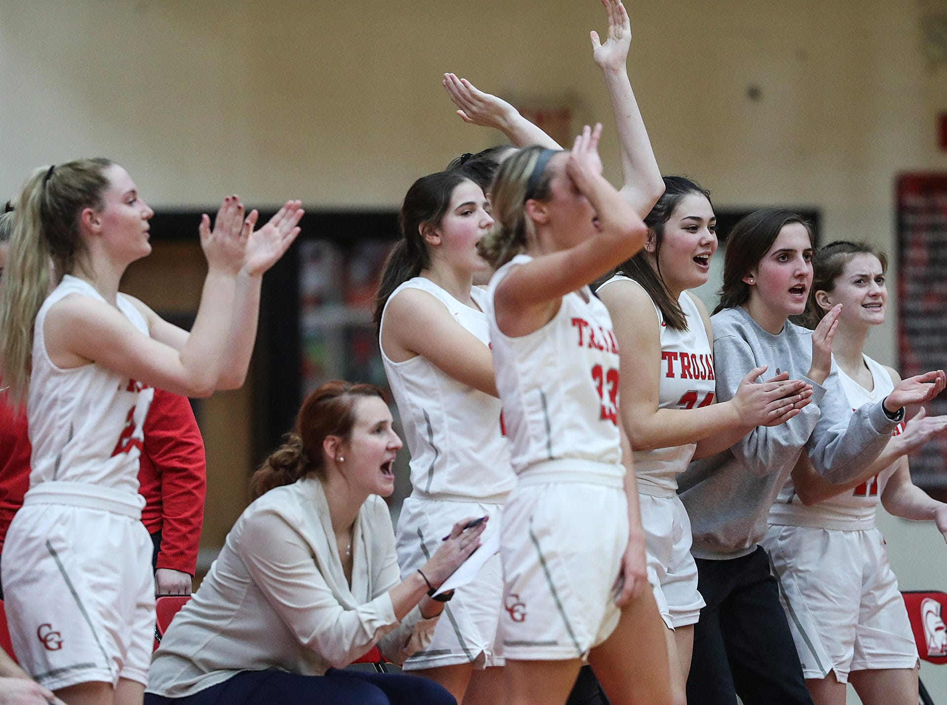 The Center Grove Trojans celebrate after guard Mary Wilson (33) scored three points in the second half of the game at Center Grove High School in Greenwood, Ind., Thursday, Jan. 10, 2019. Center Grove defeated North Central, 51-44.