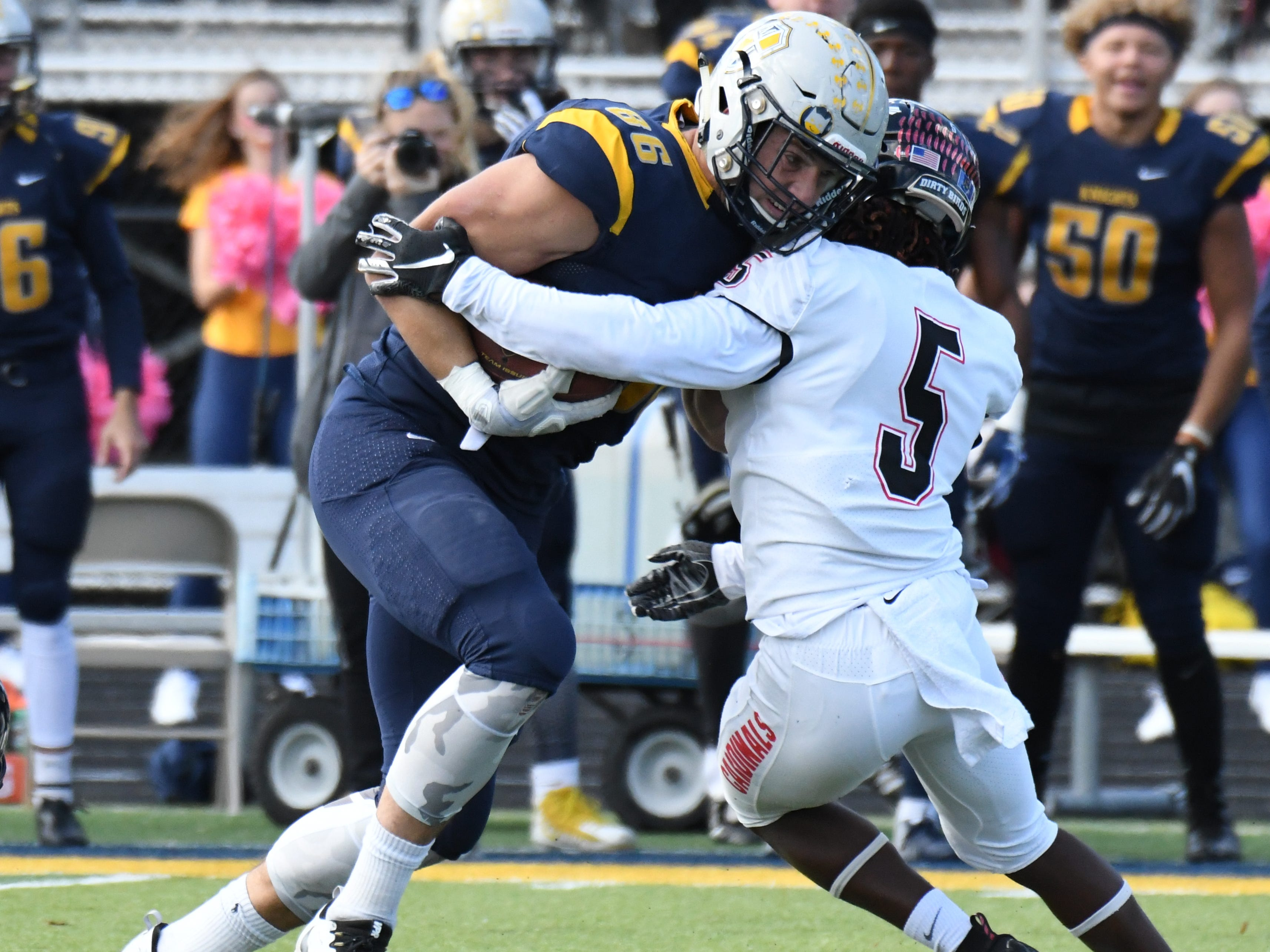 Marian University tight end Brandon Dillon powers through a would-be tackler.