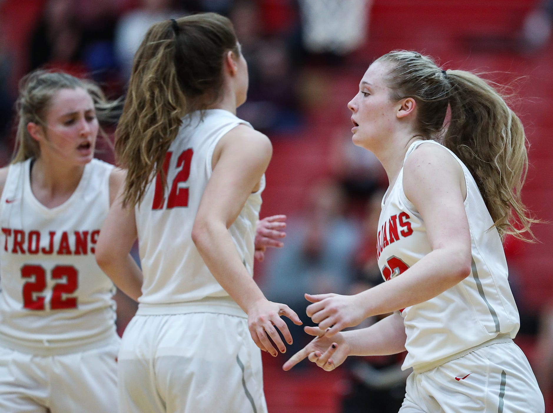 Right, Center Grove Trojans guard Mary Wilson (33) celebrates scoring a three-pointer in the second half of the game at Center Grove High School in Greenwood, Ind., Thursday, Jan. 10, 2019. Center Grove defeated North Central, 51-44.