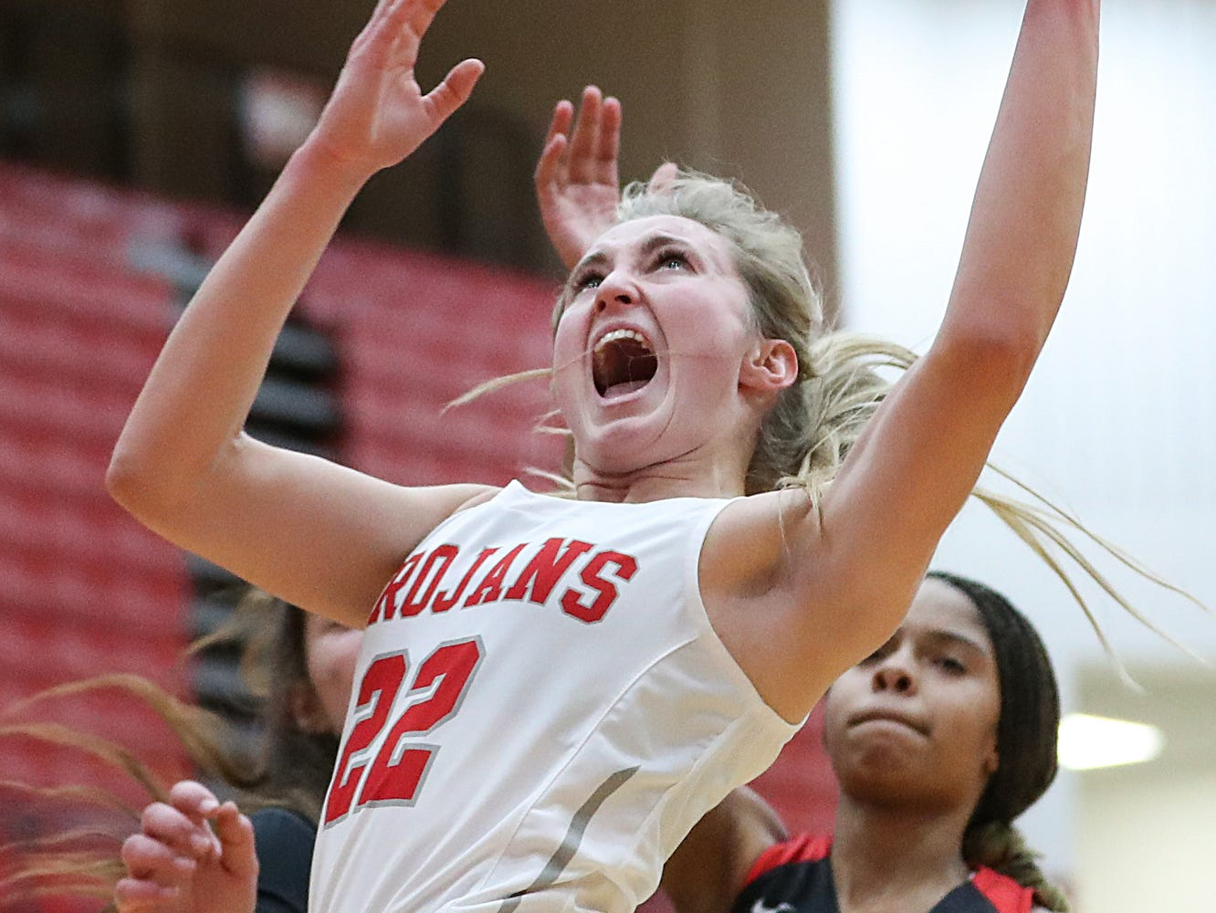 Center Grove Trojans Ella Thompson (22) shoots a layup in the first half of the game at Center Grove High School in Greenwood, Ind., Thursday, Jan. 10, 2019. Center Grove defeated North Central, 51-44.
